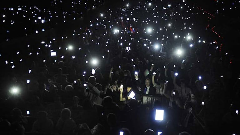 Phones and tablets are held aloft to salute the father of the web, Sir Tim Berners-Lee, at a conference in Spain.