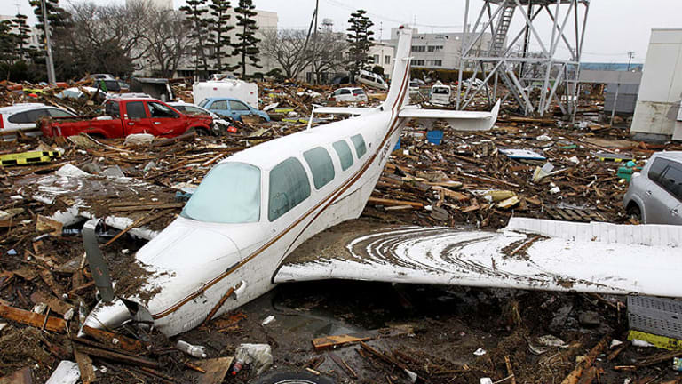 Near the city's airport, cars and planes were strewn like toys among the debris.