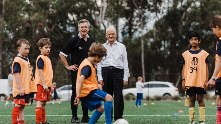 Smooth operators: Pennant Hills FC vice president Grahame Bateman and Hornsby mayor Phillp Ruddock on the synthetic field.