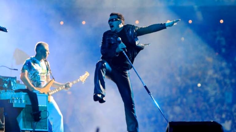 Sparkle and the spark ... Adam Clayton and Bono.