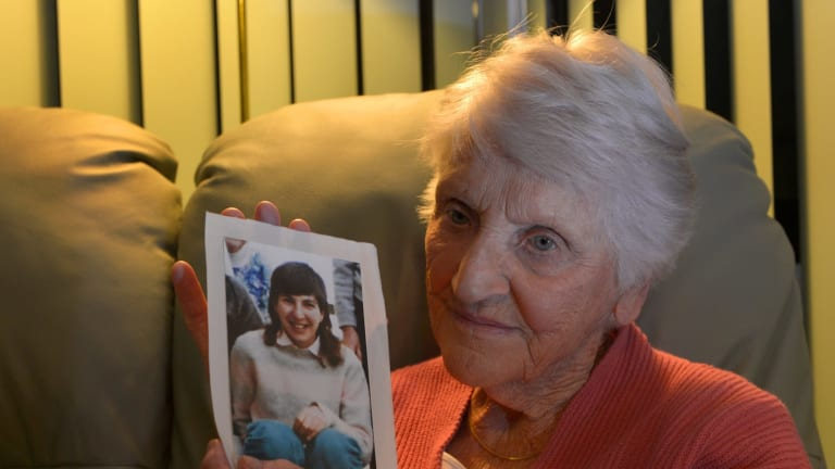 Eileen Piper with a picture of her daughter, Stephanie, who committed suicide after being sexually abused.