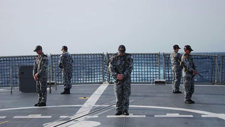 Poignant ... preparing for Anzac Day aboard HMAS Stuart.
