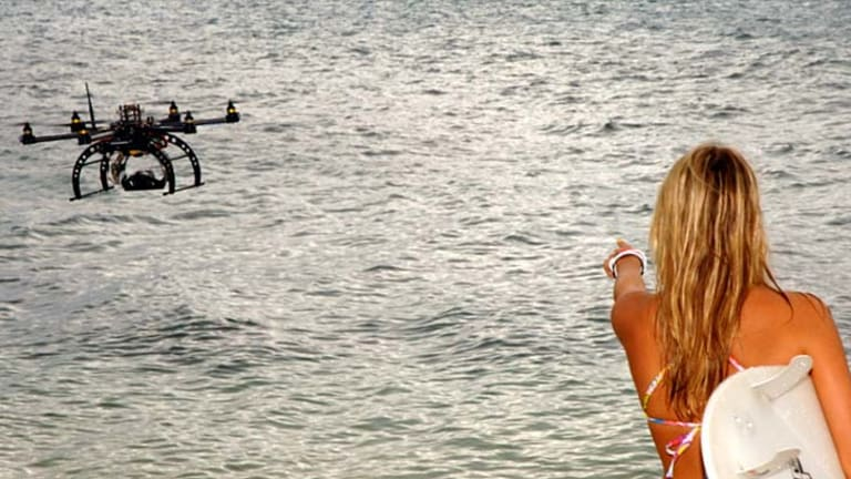 """""""Intrusive"""" technology ... a drone at the beach."""