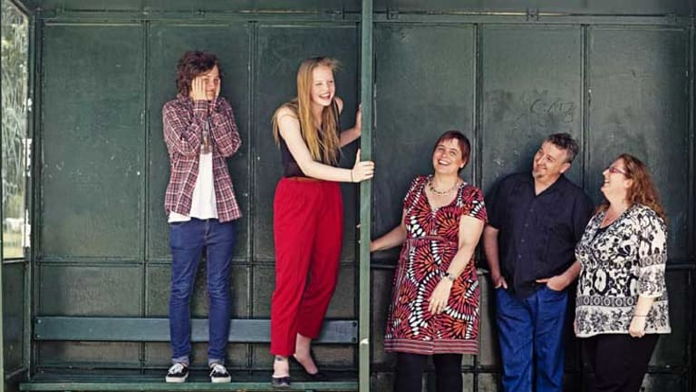 Beating it together: Troy Holland and Lucy Caldwell, both 17, with their parents (from left) Belinda and Rob Caldwell and Leeanne Campbell.