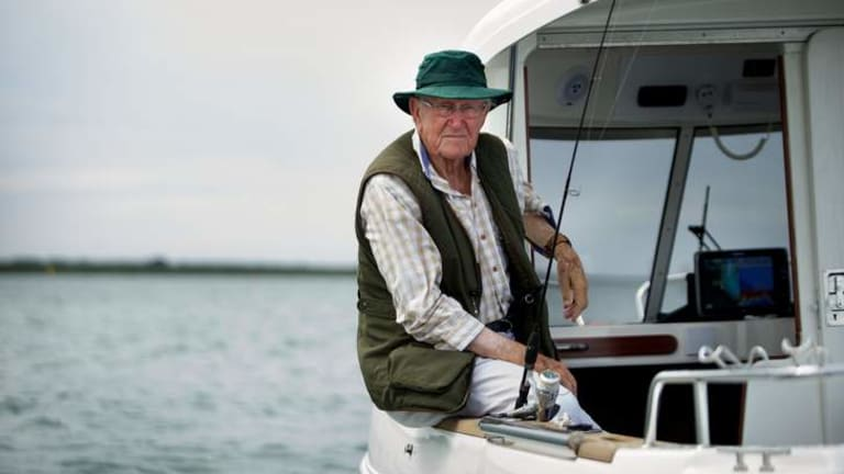 Unlikely radical: Malcolm Fraser fishing in Yaringa Harbour, south-east of Melbourne, last month.