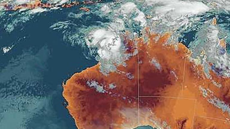 The latest satellite photo shows Cyclone Magda about to cross the coast.