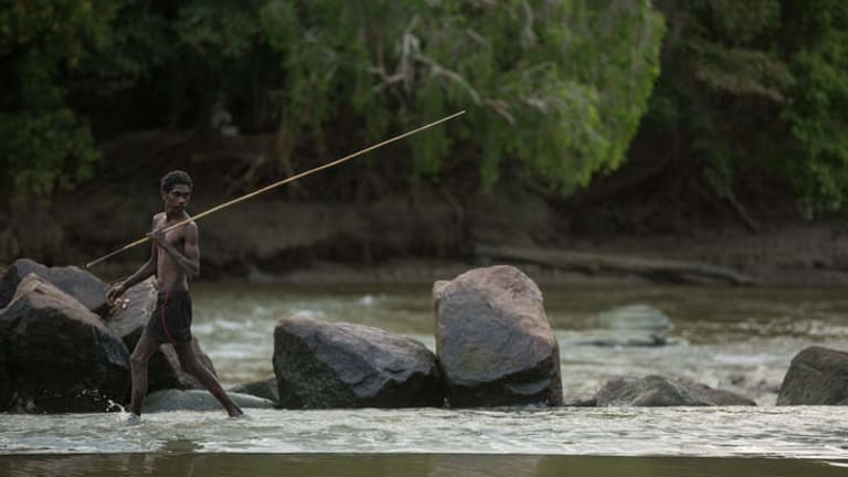 Wary: A Local fisherman fords the shallow water at Cahills Crossing on the East Alligator River.