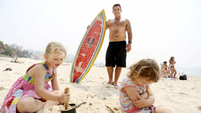 Praising the tight-knit community: Cooper Silk, who favours Bondi, with his children, Casey, 5 and Skylar, 3.