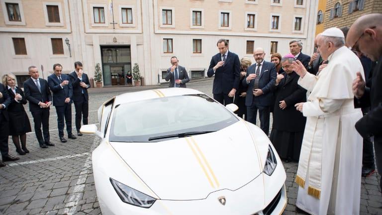 Pope Francis blesses the Lamborghini.