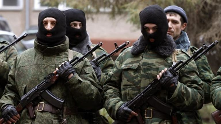 Members of a pro-Russian self defence unit stand in formation as they take an oath to Crimea government in Simferopol.