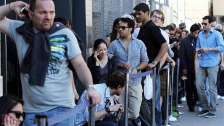 People queue outside an Apple store in Manhattan to purchase the new iPad 3G. It went on sale at 5pm Friday New York Time.  Photo: Mario Tama/Getty Images/AFP