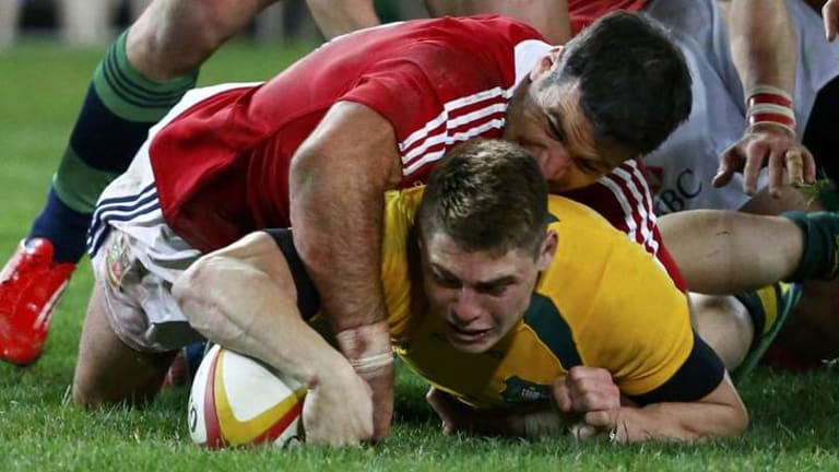 Gold fingers: James O'Connor plants the ball for the Wallabies' only try.