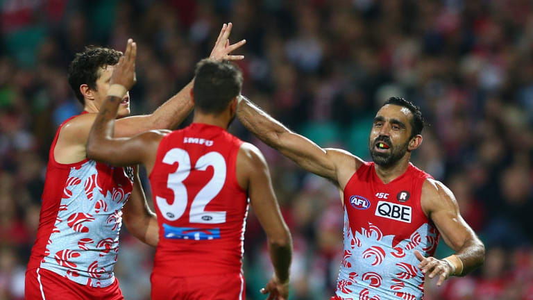 Over she goes: Adam Goodes of the Swans celebrates kicking a goal.