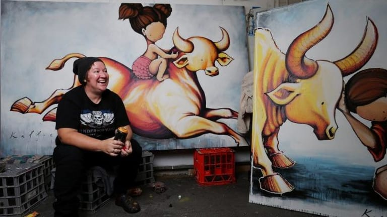 Street artist Kaff-eine with some of the work for her upcoming exhibition.
