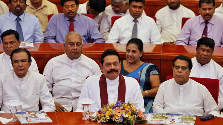 Sri Lankan President Mahinda Rajapaksa with his party members at the launch of his election manifesto in Colombo, on Tuesday.