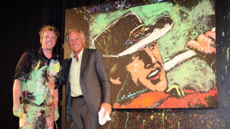 Artist Brian Olsen with Greg Norman and the amazing portrait.