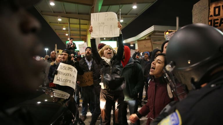 Police intervene and arrest some activists during the protest against President Donald Trump's 90-days ban at JFK airport in New York.