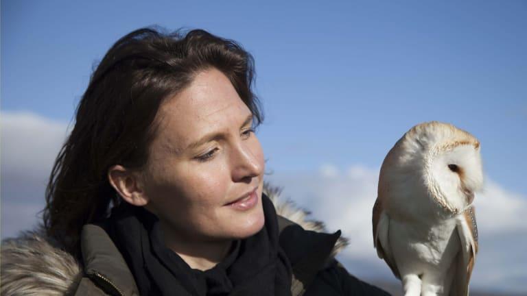 Helen Czerski in TV presenter mode with an owl for Animal Super Senses.