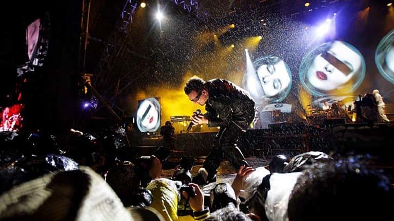 Bono of U2 serenades the Glastonbury crowd.