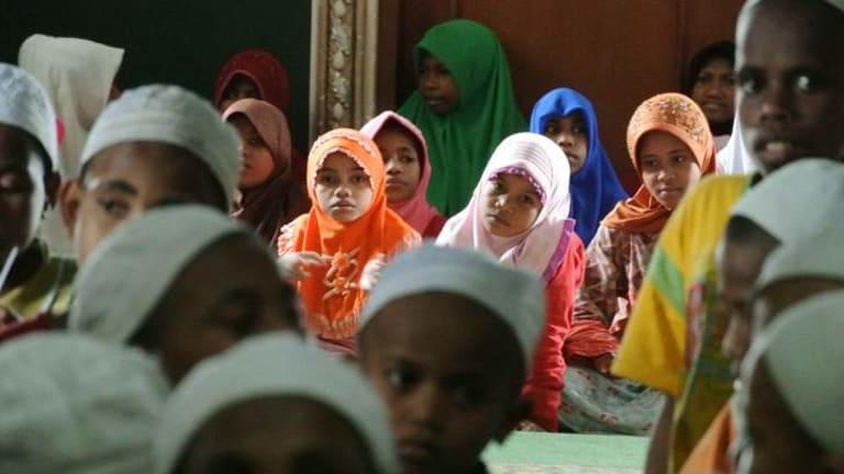 Heavy learning … boys and girls at Daarur Rasul.