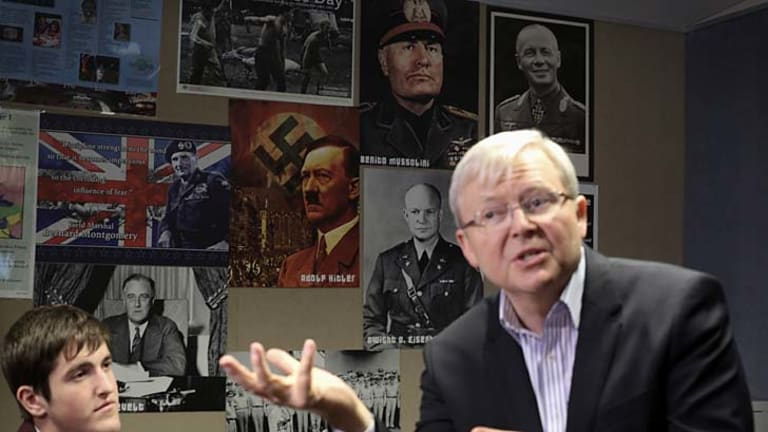 Prime Minister Kevin Rudd spoke to students at Bede Polding College with posters of Hitler, Mussolini, Rommel and Einsenhower on the wall.