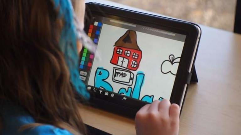 Student using iPad at school