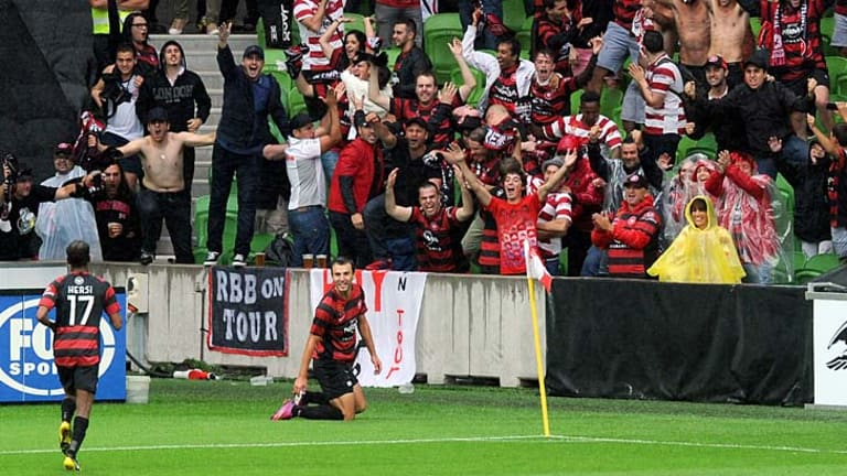 Inspired: Wanderers fans show their delight as Labinot Haliti celebrates his goal against Melbourne Heart at AAMI Park.