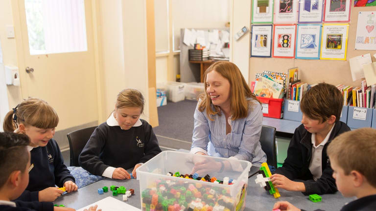 Sum total of effort and passion: Lumen Christi Catholic Primary School teacher Cassandra Lowry delights in maths. Here she is helping her year 3 extension program students.