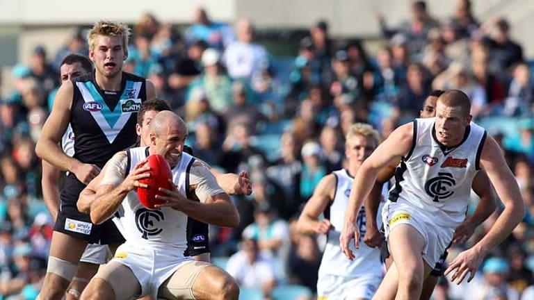 Chris Judd on his way to another three Borwnlow Medal votes against Port Adelaide, round eight, 2010.