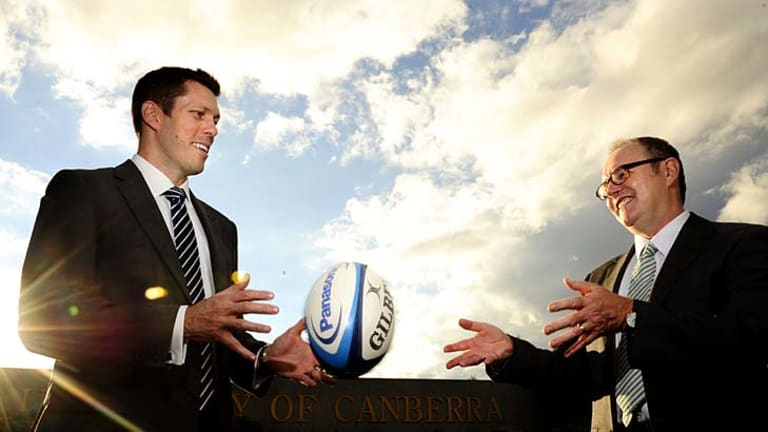 Pass mark ... Brumbies CEO Andrew Fagan (L) with the University of Canberra's Vice-Chancellor and President, Stephen Parker..