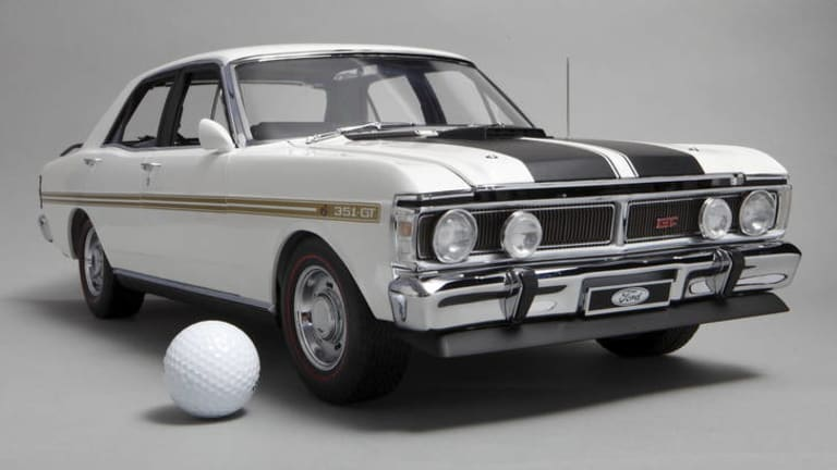 Muscular ... Icon Models' Ford Falcons in one-eighth scale (the golf ball is for size comparison) are worth $1295, or $2000-plus on the secondary market.