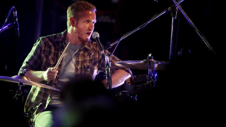 Tim Hart in his role as Boy and Bear drummer.