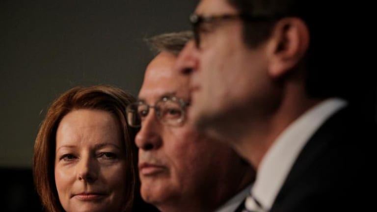 Prime Minister Julia Gillard, Deputy Prime Minister Wayne Swan and Climate Change minister Greg Combet following the passing of the Carbon Tax Bills.