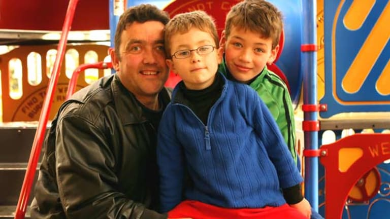 Tony Holland, with sons Luke and Trent, says many people can't eat into their budget any more.
