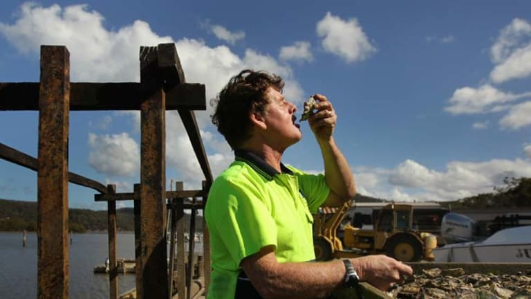 The consultation process was ''just tick a box'' ... Rob Moxham at his oyster farm at Mooney Mooney on the Hawkesbury River. He believes the decision is a foregone conclusion.