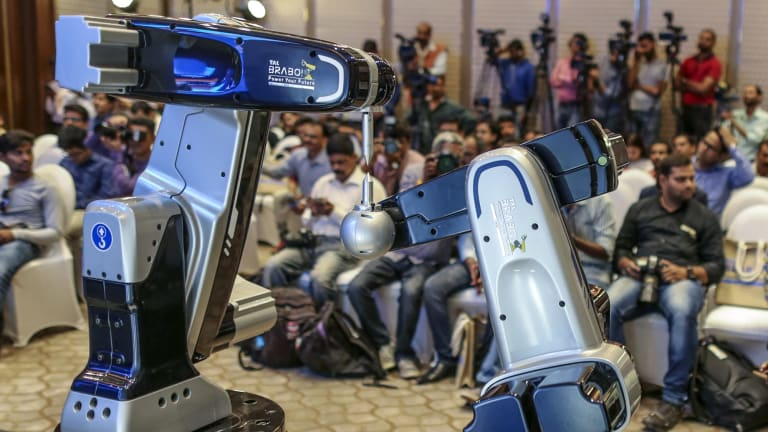 Companies need to help their workers adjust to the increasingly automated world, the money manager says.