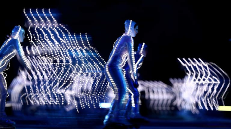 Rollerskaters perform as Olympic Gods during the Opening Ceremony of the Sochi 2014 Winter Olympics.