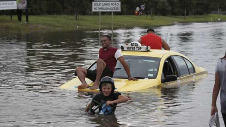 A marooned taxi in waters at Narre Warren.