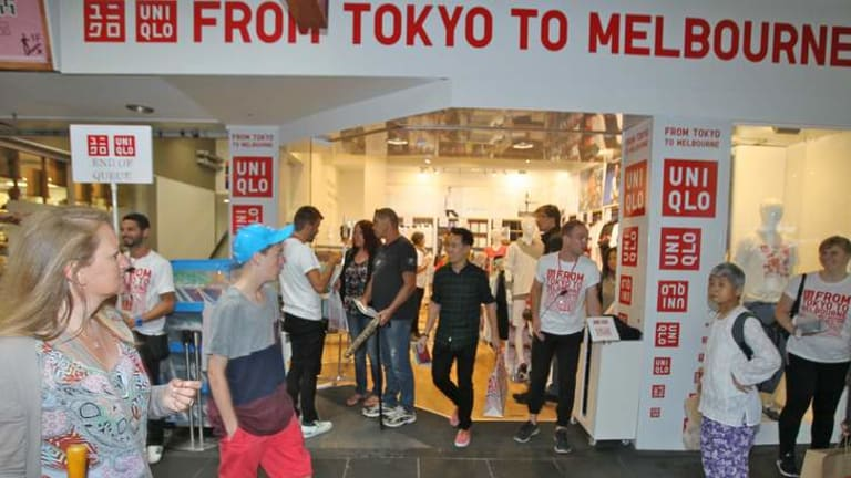 Shoppers queue to check out Uniqlo's pop-up shop in the city.