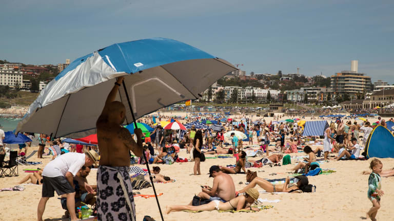 Late spring heat brought people to beaches in Melbourne while Sydney will likely post its fourth-warmest December.