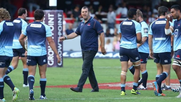 Unruffled: Waratahs coach Michael Cheika with his team before the match against the Sharks.