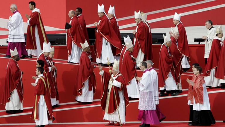 Pope Benedict XVI with Catholic clergy at World Youth Day in Sydney where he apologised for sex abuse by clergy.