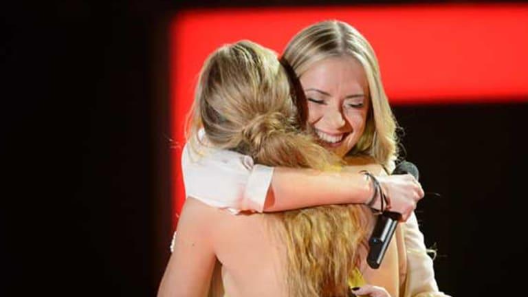 Frenemy hugging: Brittany Cairns and Kelsie Rimmer.
