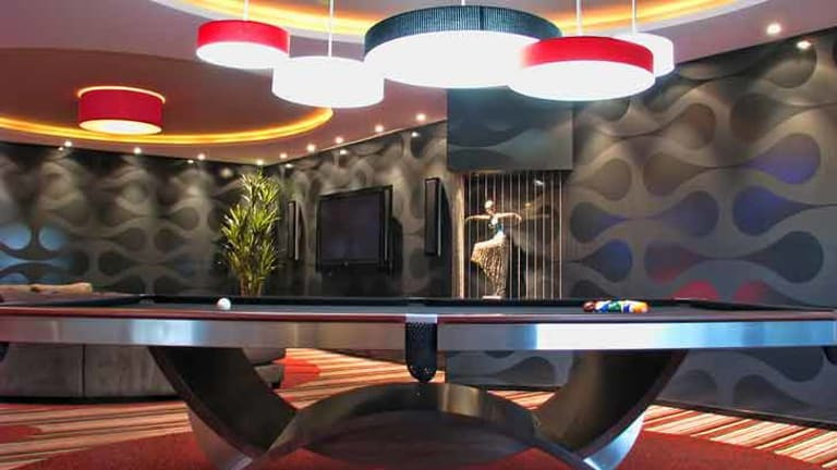 A custom-made pool table, dramatic lighting and groovy wallpaper in the Sunshine Coast man cave designed by Mark Gacesa.