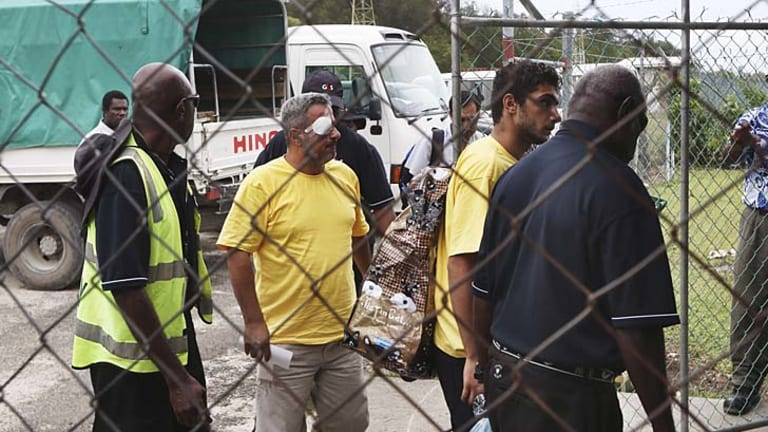 Injured asylum seekers on Manus Island.
