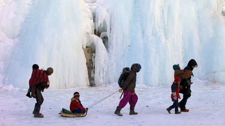 Whiteout: Children being accompanied to school along the Chadar.