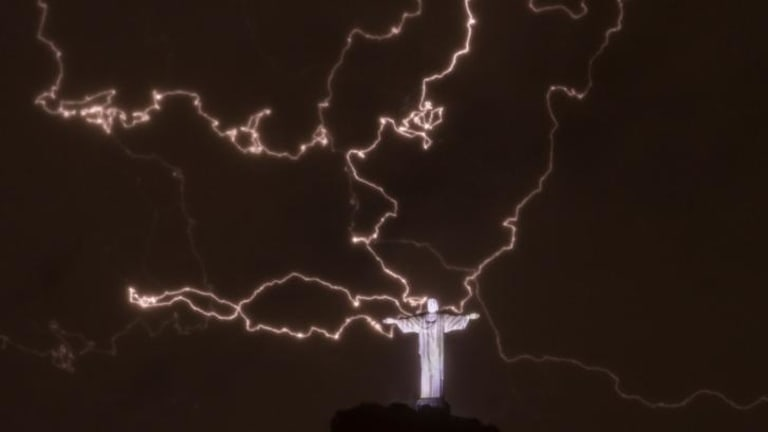 Lightning flashes over the statue of Christ the Redeemer on top of the Corcovado mountain in Rio de Janeiro, Brazil.