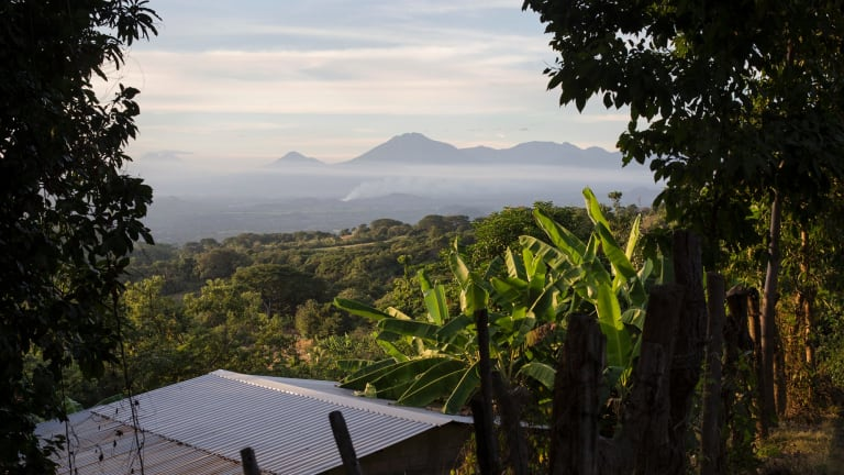 Some of El Salvador's 23 volcanoes overlooking the lush agricultural lowlands: living beneath volcanoes gives locals an appreciation of life, says Dr Ramon Garcia-Trabanino.