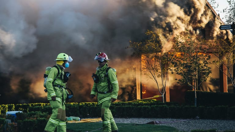 Emergency services work to extinguish the fire at Pialligo Farmhouse Restaurant.