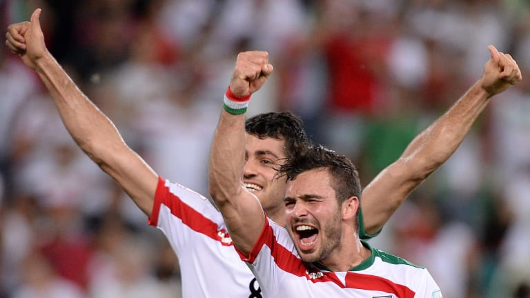 Players warned against selfies with female fans ... Soroush Rafiei and Morteza Pouraliganji of Iran celebrate their team's victory over the UAE at Suncorp Stadium in Brisbane.